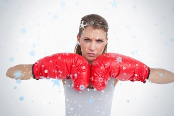 Serious woman with boxing gloves