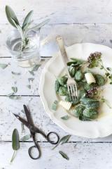 homemade spinach dumplings, sage leafs, butter curls, flowers
