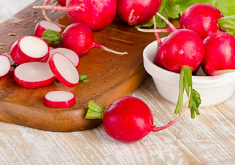 Fresh radishes on   wooden board.