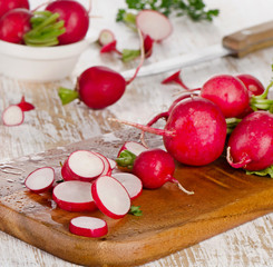 Fresh radishes on a  wooden table.