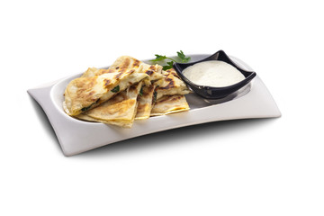 Flat bread stuffed with cheese and herbs
