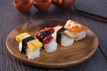various sushis with wood background