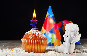 Sweet Biirthday muffin with candle