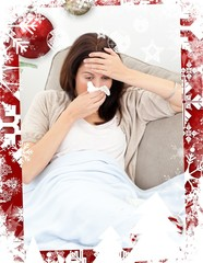 Tired woman feeling her temperature while blowing her nose