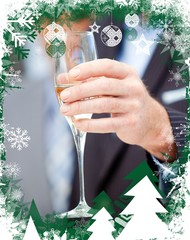 Businessman holding a glass of champagne