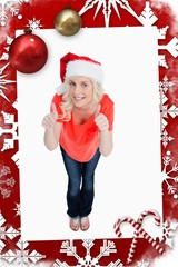 Woman putting her thumbs up while wearing christmas clothes