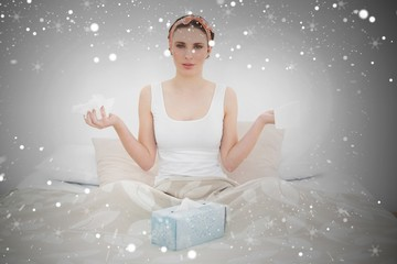 Composite image of sick woman holding handkerchiefs