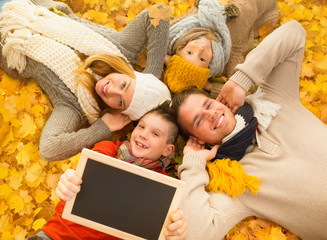 happy autumn family with board
