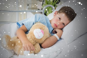 Little boy with teddy bear in hospital