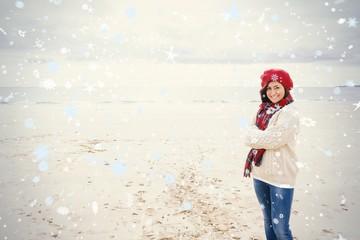 Portrait of a pretty woman in stylish warm wear at beach
