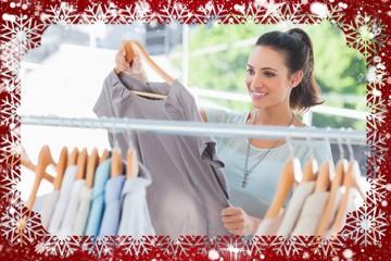 Composite image of fashion woman choosing dress