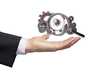 gears magnifying glass businessman