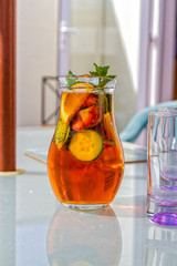Jug of Pimms on a glass table