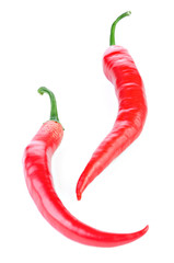 Two ripe red hot chili peppers