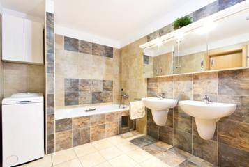 Modern green bathroom with two washbasins