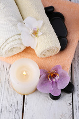 Still life with beautiful blooming orchid flower, spa set