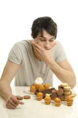 Man in love with sweets, candies,chocolate and sugar, abstain