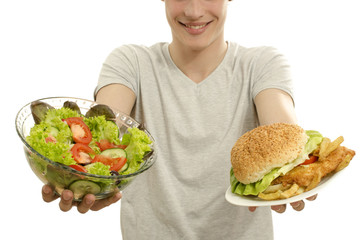 Man offering you a salad and a hamburger, fast food or organic