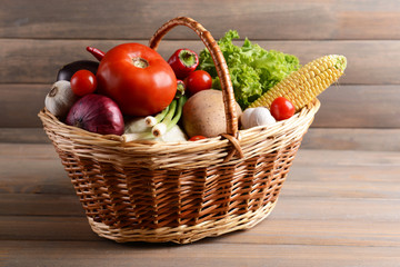 Fresh organic vegetables on wooden background