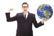 Successful businessman holding the world