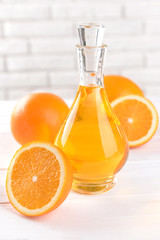 Tangerine oil on table on light background