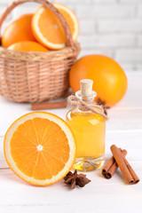 Tangerine oil on table on light background