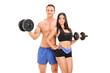 Male and female athletes posing with barbells