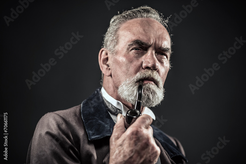 Leinwanddruck Bild Pipe smoking vintage characteristic senior man with gray hair an