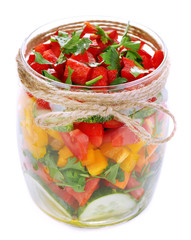 Vegetable salad in glass jar, isolated on white