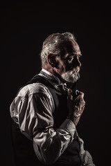 Pipe smoking vintage characteristic senior man with gray hair an