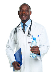 Portrait of a smiling male doctor holding bottle of water on whi