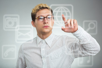 Young businessman pressing application button on computer with t