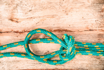 Knotted rope on wooden surface
