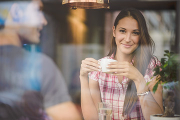 Young couple on first date drinking coffee