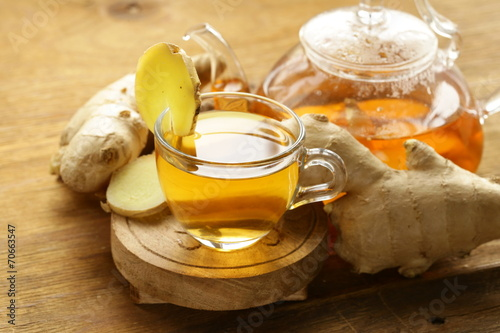 Fotobehang Thee beverage tea with ginger and fresh root on a wooden background