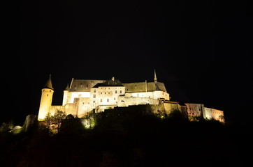 Night view over medieval castle in Vianden, Luxembourg.