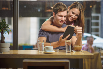 Young couple looking tablet