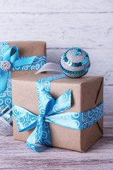 Holiday gift boxes decorated with blue ribbon