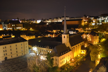 Night view over neumunster abbey complex