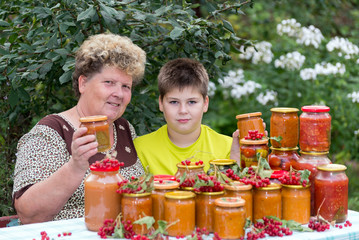 Grandmother and grandson with  homemade preserves