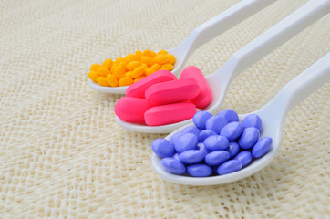 colorful medicine tablet on the spoon