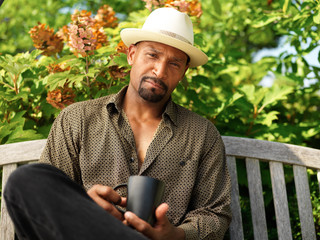 portrait of mature african man with cup of morning coffee