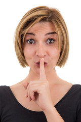 woman making silence sign with her finger