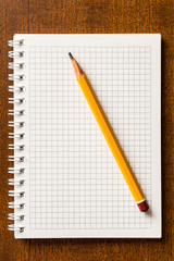 The pencil and notebook