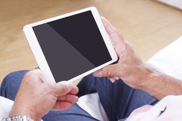 Digital tablet using by senior man