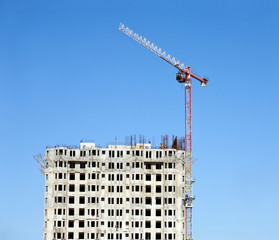 Hoisting tower crane and top of construction building
