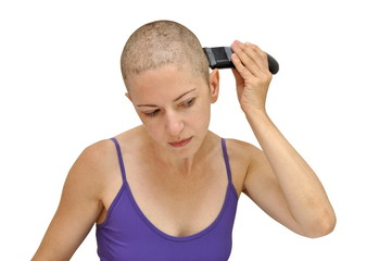 Woman in purple bodice shaving herself bald using left hand