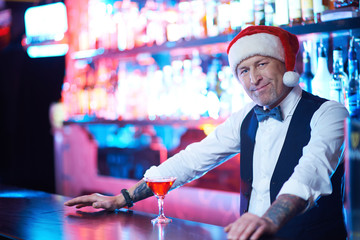 Barman in Santa cap