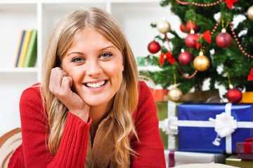 Beautiful young blonde woman enjoying in Christmas holidays