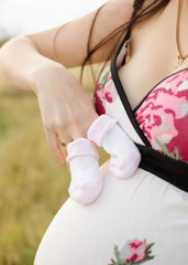 Baby socks on pregnant tummy